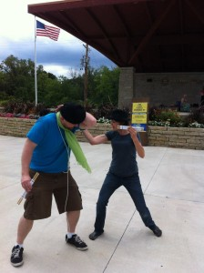 Jessie as Antipholus of Syracuse, practicing some violence with Christopher Elst as Dromio of Ephesus